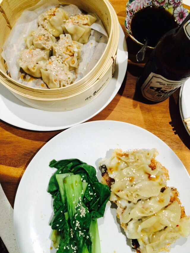 Gyoza, steamed dumplings and boy choy